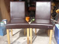 two handy light dark chairs,in dark leather style vgc.will deliver local if needed