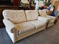 beige patterned fabric two.seater sofa and Armchair suite