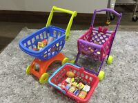 Two trollies one basket and play food