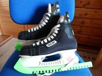 Adult Bauer Protean roller blades. once used.size 5 1/2 with guards £30