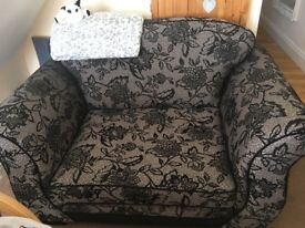 One seater sofa , dfs , grey with black detail