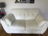 White leather sofas with footstool