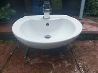 Semi recessed wash basin c/w waterfall tap and spring waste