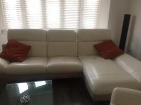 White and cream leather sofa and matching leather chair