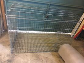 Dog crate with black tray.