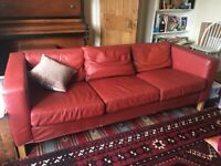 Dark red IKEA ARILD leather sofa, three seater, good condition,