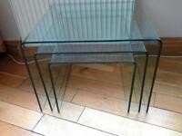 Nest of three large curved glass coffe tables
