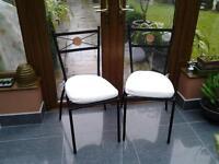 2 black metal bistro chairs