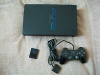 PS2 Console + 4 games + Wheel and pedals + memory card