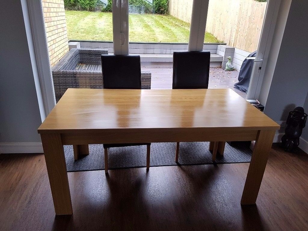 Oak effect dining table and 4 leather chairs