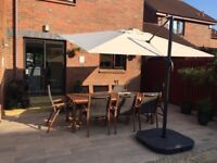 Dobbies 8 seater fsc table and chairs with large Ikea sun canopy with covers only used a few months