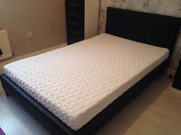 Small double bed with mattress.