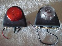Two Britax Trailer indicator lights showing white and red,could be mudguard or front trailer mounted