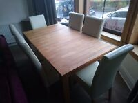 New and rarely used 4 seater couch and Oak table with Leather Chairs