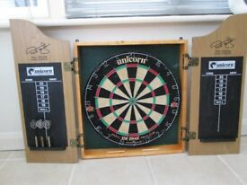dartboard in cabinet good condition