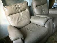 Two electric reclining leather armchairs