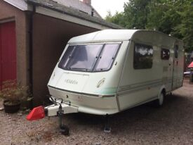 Eldis Typhoon XL 1000 4 berth caravan with large awning and motor mover.