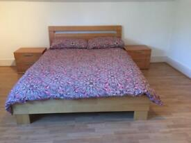 Double bed with two side tables