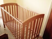 Wooden cot in Excellent condition - fits to parents' bed if necessary