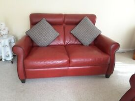 Two seater red leather sofs