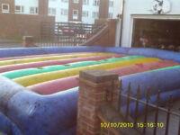 bouncy castle gladiator dual
