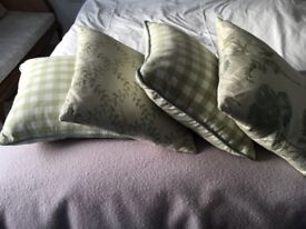 A set of 4 cushions in soft green