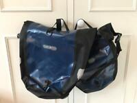 Two blue Ortlieb pannier bags
