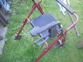 Lightweight aluminium 4 wheeled rollator with brakes slight damage to one wheel does not affect use