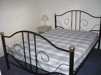 Metal framed double bed and mattress