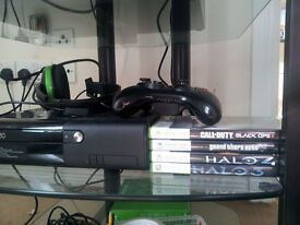 xbox 360 E 250gb with 4 games controller headset and cables