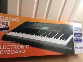 Casio electronic keyboard+stand