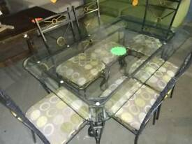 Glass and wrought iron dinning table with 6 matching chairs