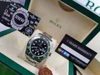 New boxed with papers silver bracelet black dial green ceramic bezel Rolex submariner 50th annivers
