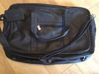 Black leather Skyflite bag. Hand luggage size.