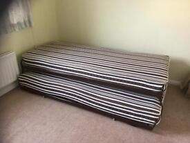 Single bed with pull out under bed, to make 2singles