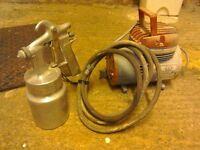 Two mini compressors and spray gun.