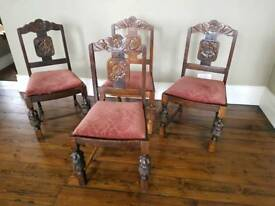 4 Solid Oak carved chairs