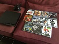 PS3 Slim Bundle with 11 Games and 2 Remote Cotrollers & Charging Station