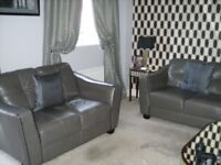 Beautiful Almost New - 2 Grey 2 Seater Leather Sofas