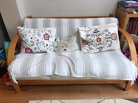 Double futon with light wood frame