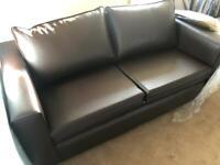 Brand new 2 seater dark brown sofa