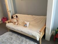 Double Futon. Wooden frame and cream matress. Used but in excellent condition.