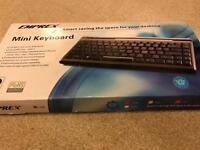 Mini keyboard + laptop stand