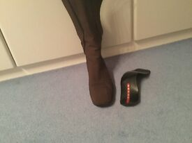 Prada knee length boots in brown with back zip