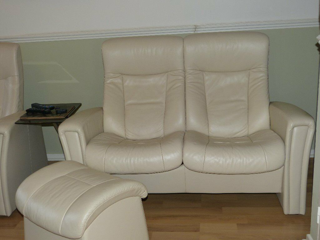 2 Seat cream leather recline action sofa with matching footstool like stressless