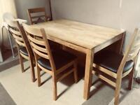 Dining table and four chairs. Solid oak