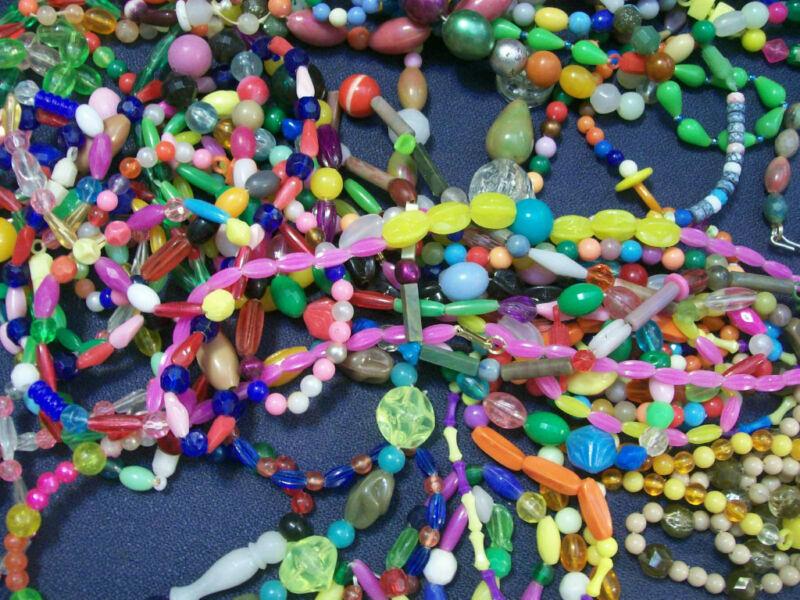 25 Vintage 1960s-70s Plastic strung Mardi Gras Beads Necklaces