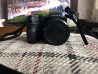 Fujifilm Finepix S2000 Excellent condition with case and hdmi cables. No charger.