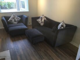 4 seater sofa and 2 seater snuggler imcluding 2 footstools (with storage) and 5 cushions