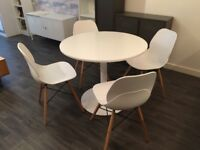 Modern Charles Eames Paris style dining chairs and pedestal table